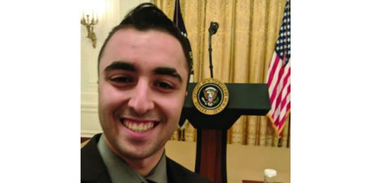 Junior accounting major and Turning Point USA president Joshua Aminov poses at the White House during his March 21 visit.